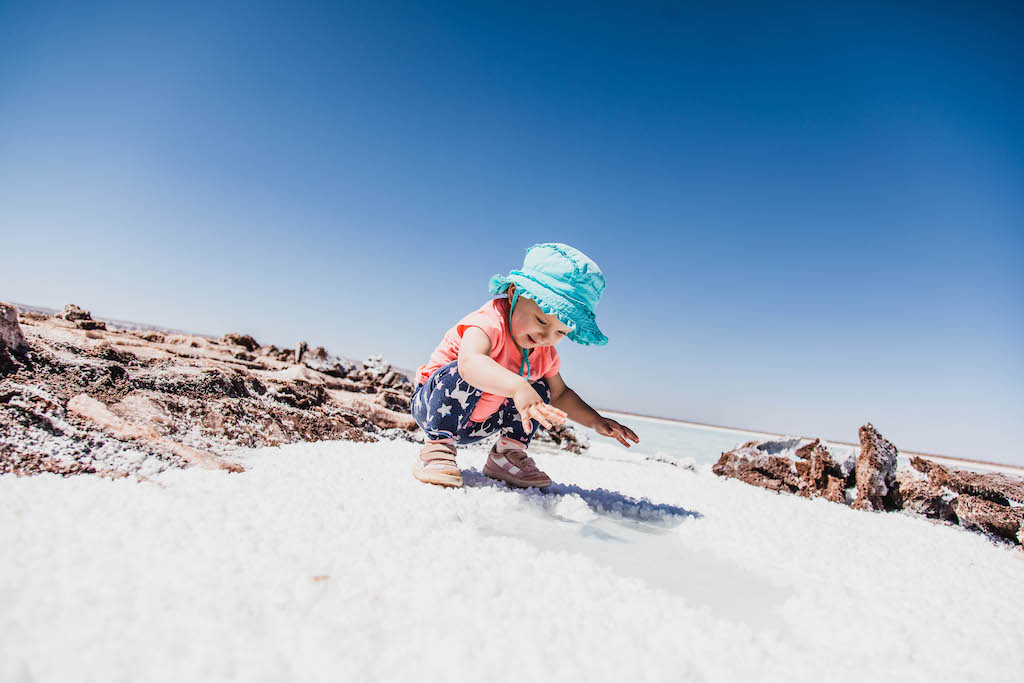 Toddler playing with salt at Lagunas Escondidas de Baltinache