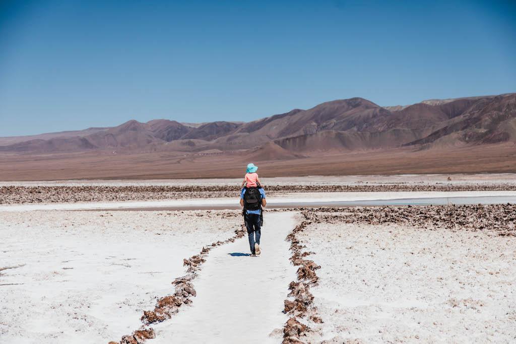 Toddler and dad walking through Lagunas Escondidas de Baltinache