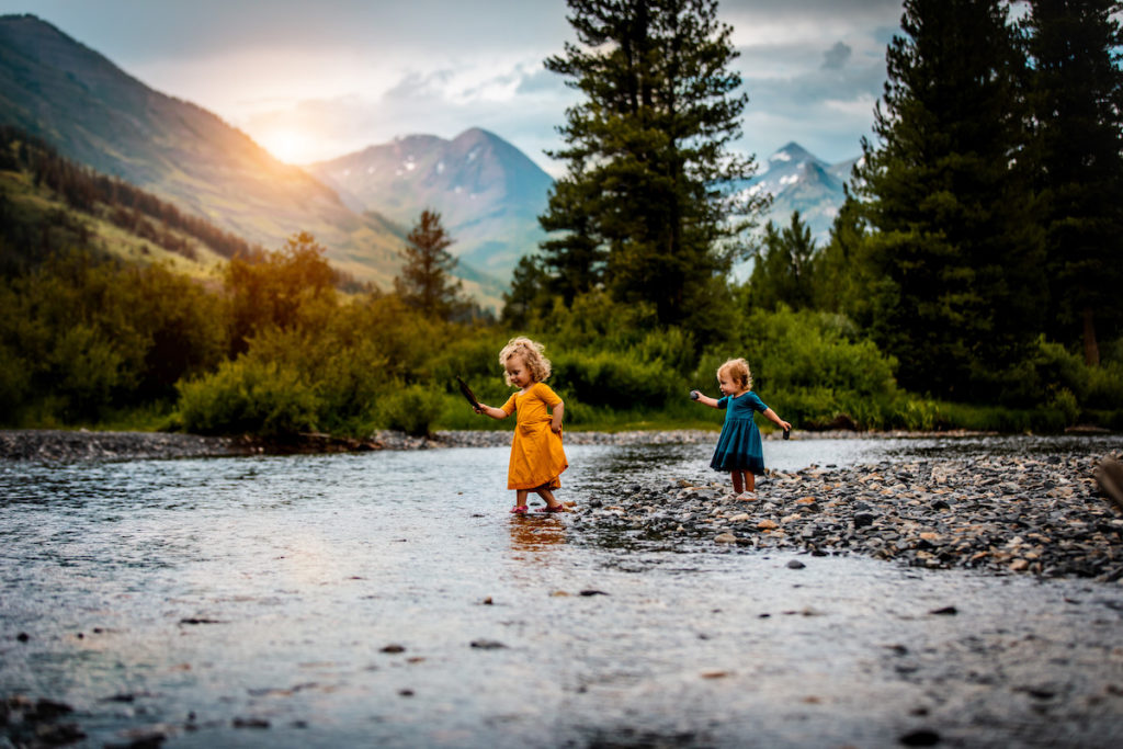Kids playing with rocks at a creek in Crested Butte