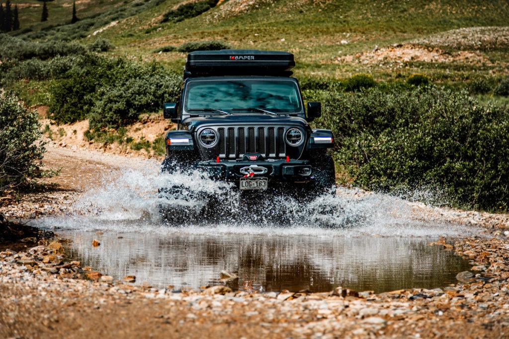 Jeep driving through rough terrain
